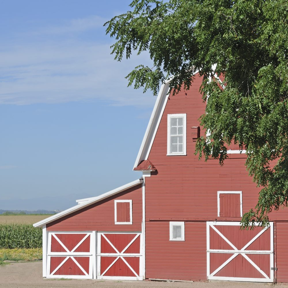 Traditional red and white wooden farm building in Colorado, US