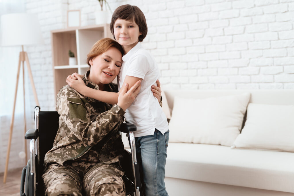 Woman veteran in wheelchair returned home. The son is happy