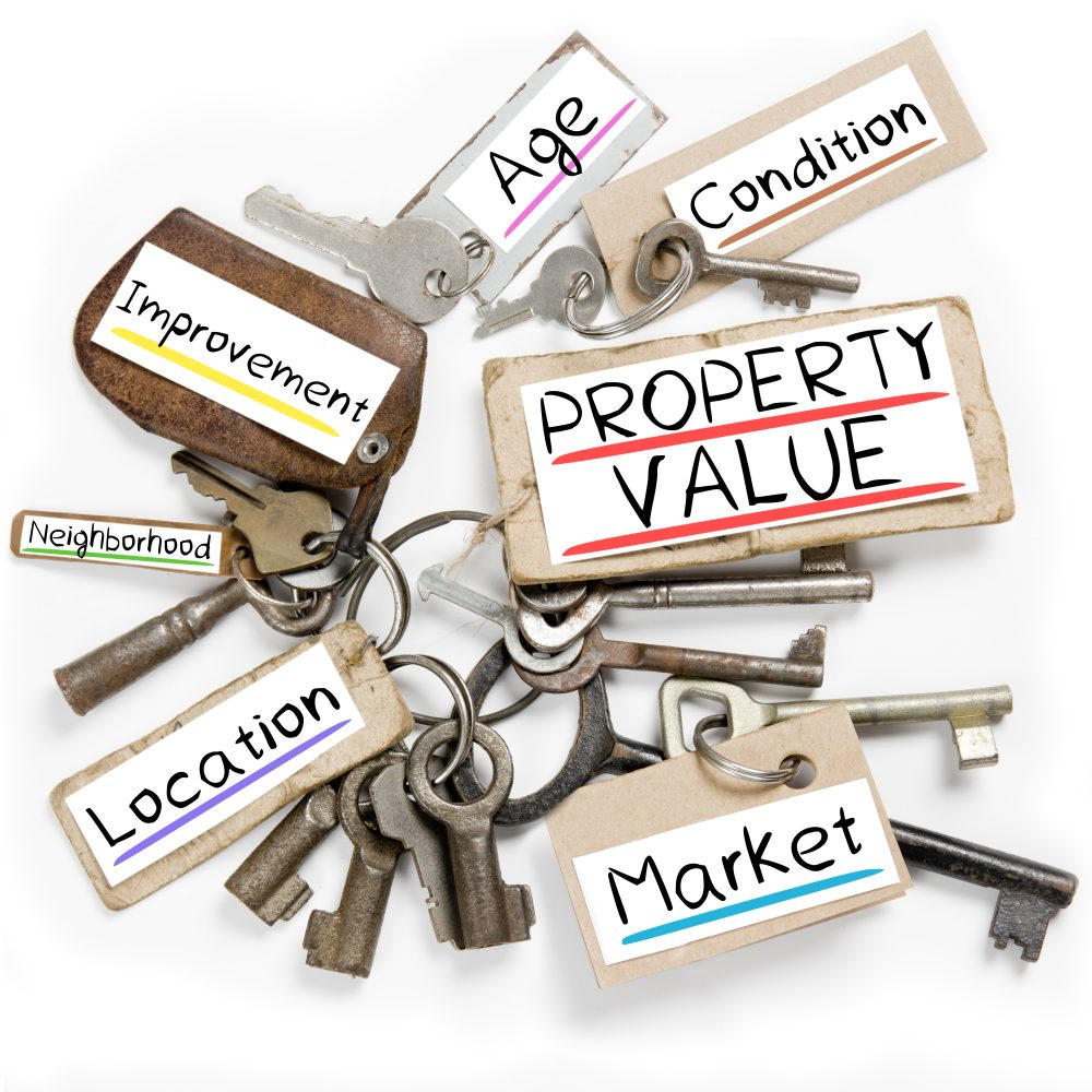 Photo of key bunch and paper tags with PROPERTY VALUE